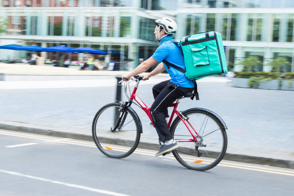 Deliveroo driver on a bike